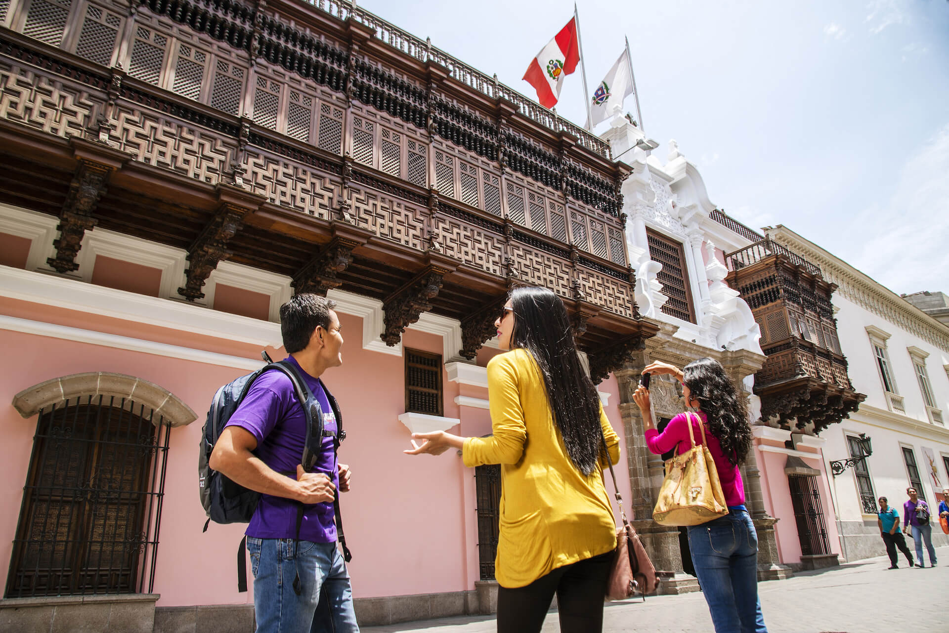 Tourists taking photographs of Buildings in Lima