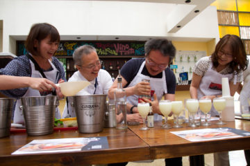 People making Pisco Sours with Lima Mentor Guide